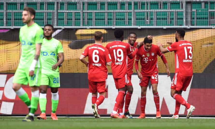 Jamal Musiala celebrates his second, and Bayern's third at the Volkswagen Arena.