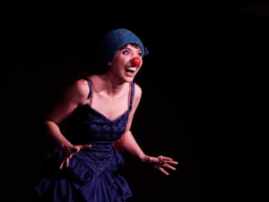 Elizabeth Davie in a blue dress and hat with a red plastic nose