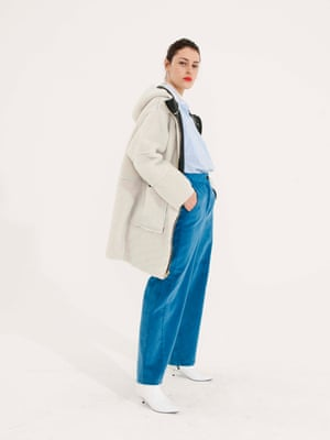 white shearling coat Asos, pale blue and white shirt Kin from John Lewis, blue wide legged cords Finery, white boots Topshop