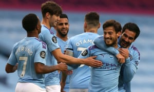 David Silva of Manchester City (second right) celebrates after he scores his sides fourth goal.