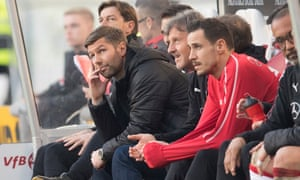 Stuttgart's head of sport Thomas Hitzlsperger sits on the bench during the game against Leipzig.