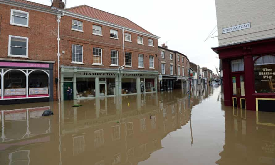 Businesses on the corner of Merchantgate and Walmgate are surrounded by floodwater.
