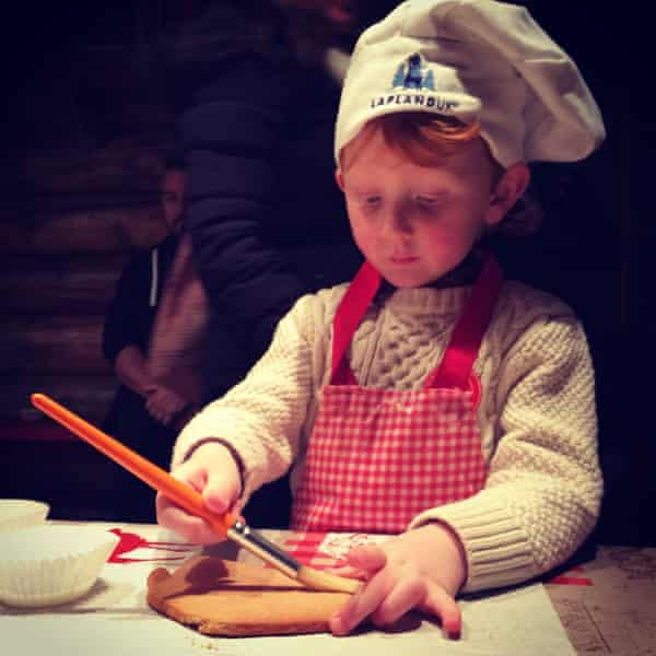 Children get to decorate gingerbread.