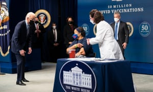 President Biden with Victoria Legerwood Rivera, who received her vaccine shot at at event to mark 50m doses, part of the White House effort to build confidence in the vaccination plan.