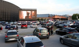 People watch a movie from their cars at an open air cinema event in Brussels, Belgium on 3 July, 2020.