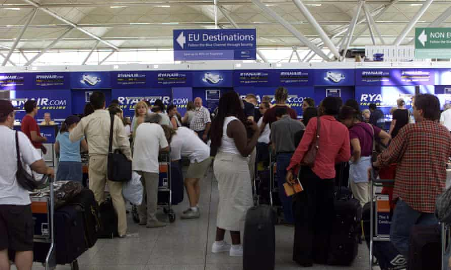 Queues at the Ryanair desk at Stansted Airport