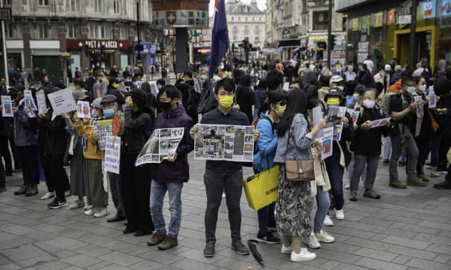 Activists in London demonstrate in support of Hong Kong's Apple Daily staff and executives.