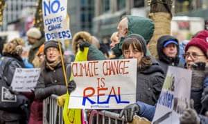 Climate change placards at protest against Trump's cabinet picks, New York, USA - 09 Jan 2017