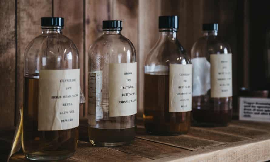 Samples of Clynelish whiskey inside Brora Distillery, Scotland.