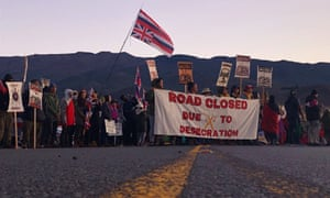 Demonstrators block a road at the base of Hawaii's tallest mountain, on 15 July.