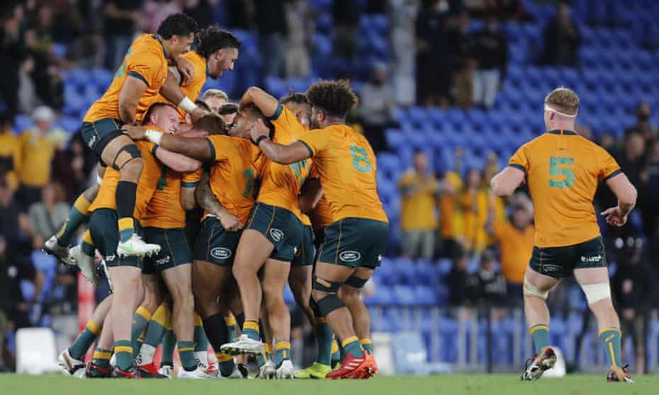 Quade Cooper is mobbed by teammates