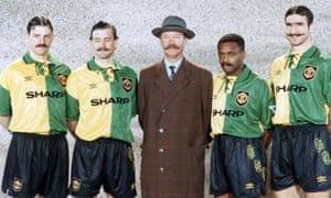 Lee Sharpe, Mark Hughes, Alex Ferguson, Paul Parker and Eric Cantona pose at a kit launch in 1993 to honour Manchester United's Newton Heath origins.