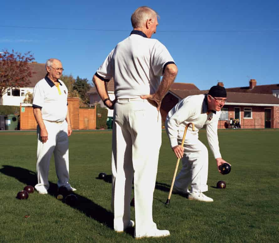 Duncan Stevens (holding ball) with two other players at Minehead bowls club