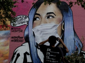 San Antonio, US A mural of Cardi B that has been updated by the artist to include a face mask