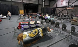People seek shelter from below freezing temperatures inside a church warming center in Houston.