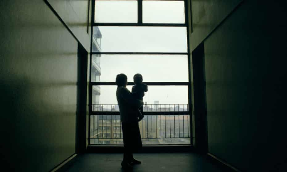 The silhouette of a 17 year old homeless girl with her baby in a corridor in a London building.