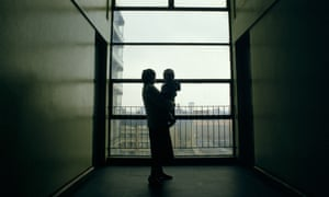 A woman and baby in a block of flats