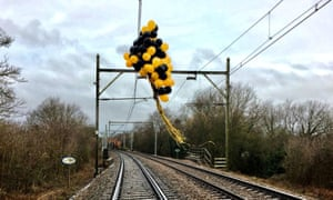 Helium-filled balloons tangled around high-voltage overhead railway wires near Southend