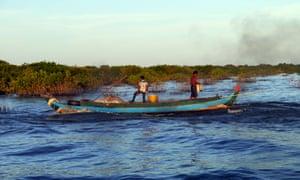 Fishermen at work on Tonlé Sap lake, Cambodia