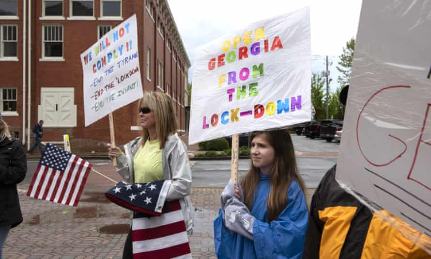 People protest stay-at-home orders outside the Cherokee county courthouse in Canton, Georgia, on 19 April.