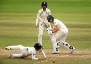 Meg Lanning of Australia plays a shot as Tammy Beaumont of England dives.