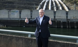 Scott Morrison poses for photographs while announcing funding for Snowy Hydro 2.0 project.