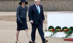 Prime Minister Theresa May and her foreign secretary in step for once at a state visit for the president of Colombia.