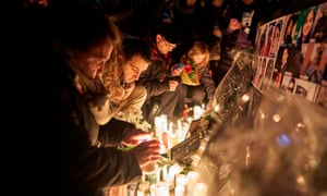 Mourners light candles for the victims of Ukrainian Airlines flight 752 in Toronto.