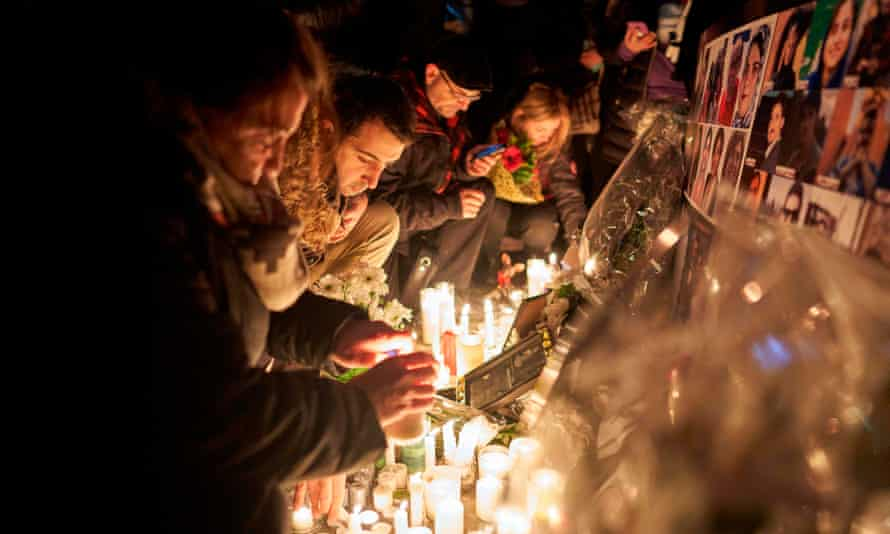 People in Toronto light candles in memory of those killed when an Iranian missile brought down Ukraine Airlines flight 752 just after takeoff from Tehran
