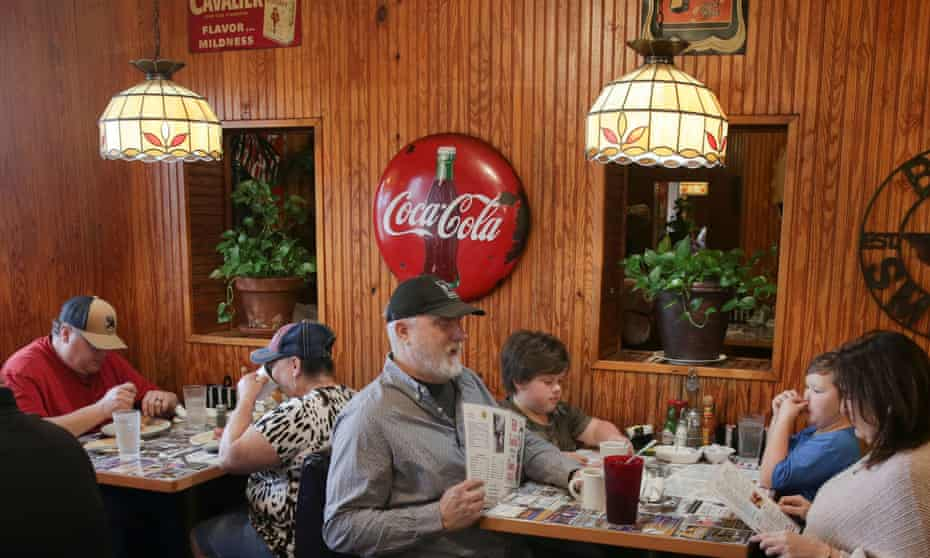People order breakfast at Bill Smith's Cafe, after The governor Greg Abbott issued a rollback of Covid restrictions in March,
