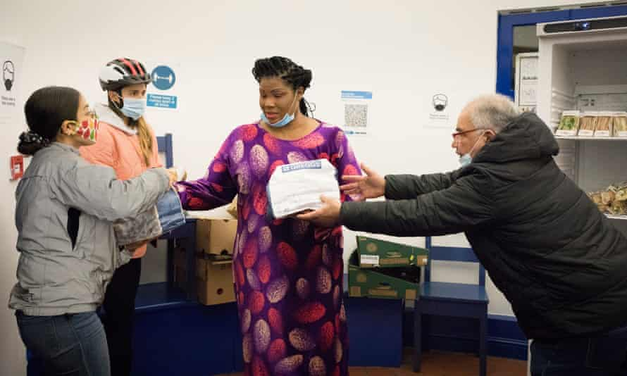 Girija Tase, 27 and Alex Brickman, 28, collect leftover food from Greggs in Brixton to deliver to a homeless outreach centre at Chandler Community Hall