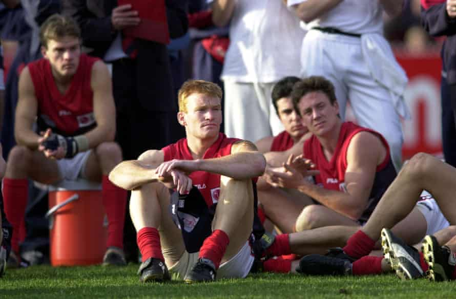 Peter Walsh and Melbourne teammates cannot hide their disappointment after losing the 2000 AFL grand final to Essendon.