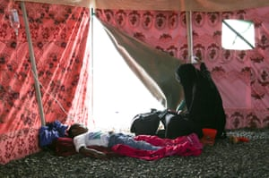 A cholera patient is treated in a tent