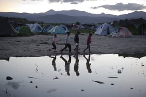 Children play in a makeshift refugee camp of the northern Greek border point of Idomeni, Greece