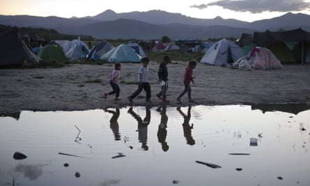 Four migrant children in a refugee camp in Grece. At least 10,000 unaccompanied children have dropped off the radar of official agencies since arriving in Europe.