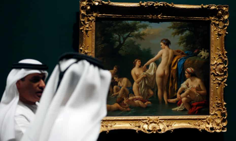 Emirati visitors look at Venus and Nymphs Bathing by Louis Jean-Francois Lagrenee, which will be displayed at the Louvre Abu Dhabi