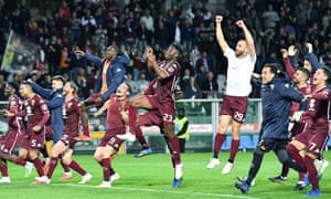 Torino's players celebrate the victory over Milan that puts them in the hunt for a Champions League place.