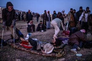 Men suspected of belonging to the Islamic State (IS) group wait to be searched by members of the Kurdish-led Syrian Democratic Forces (SDF) just after leaving IS' last holdout of Baghouz