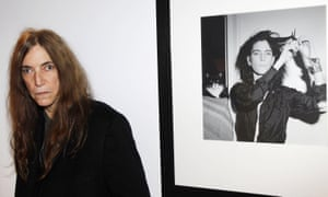 Patti Smith with a portrait of her by her friend Robert Mapplethorpe.