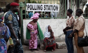 Gambians wait to cast their vote at a polling station in Banjul on Thursday