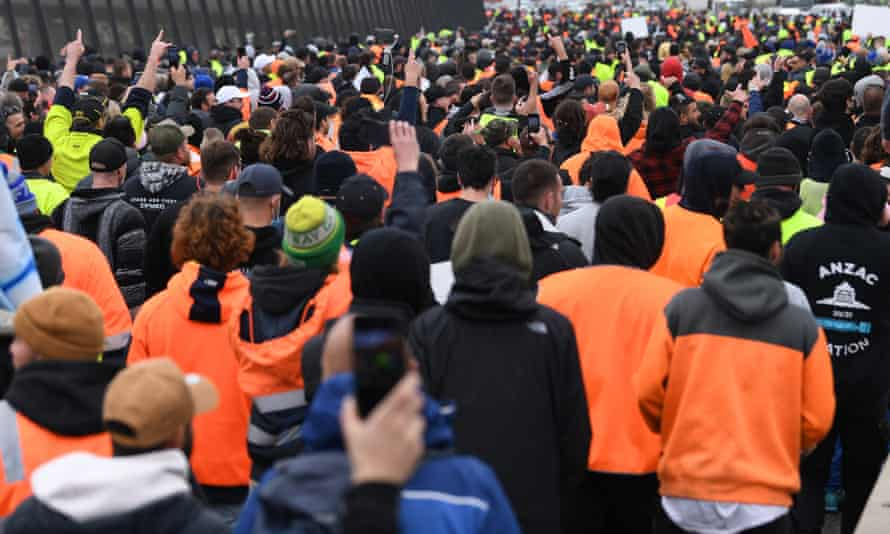 Protesters, many in hi-vis attire, on the West Gate Bridge