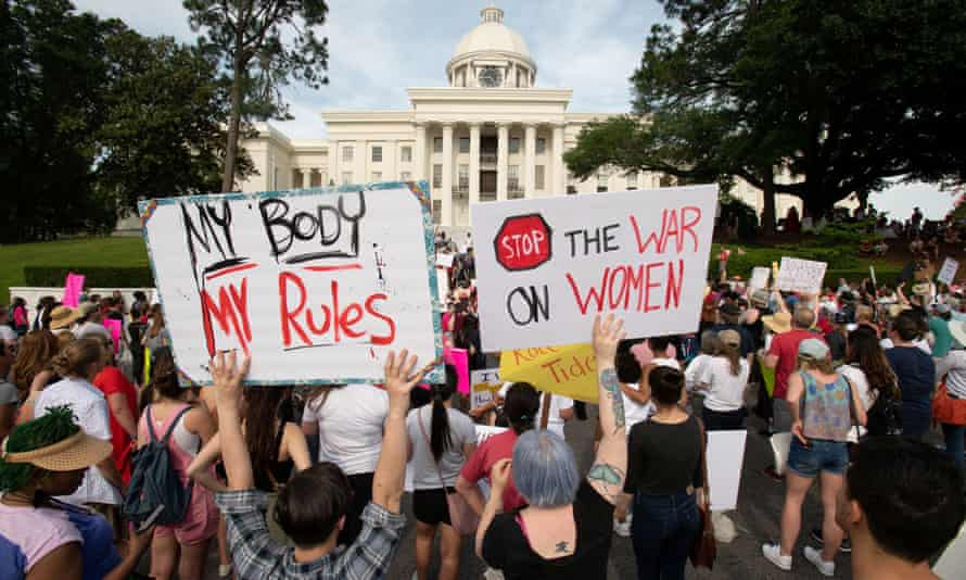 People protest Alabama's new abortion law outside the state capitol in Montgomery, Alabama, on 19 May.