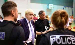 Prime Minister Boris Johnson meets rescue crews and residents