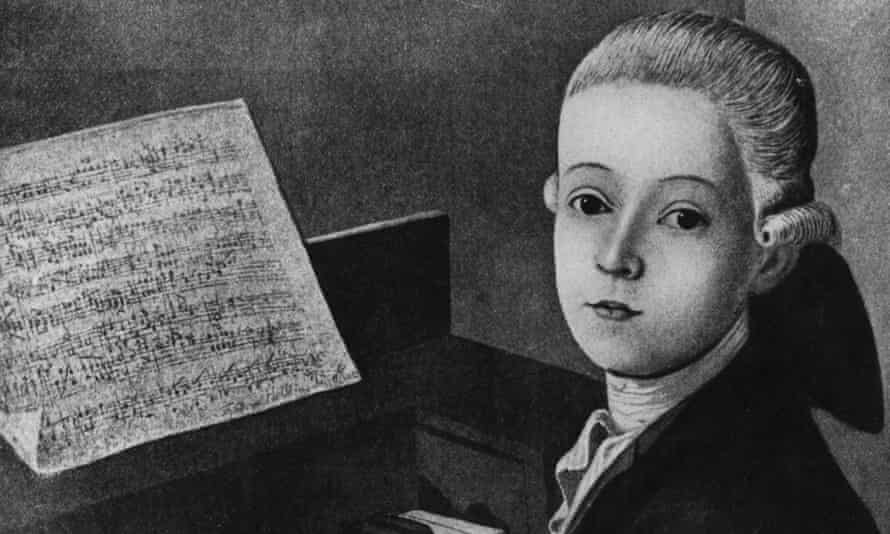 Wolfgang Amadeus Mozart shown as a young boy at the piano in a painting by JN Helbling.