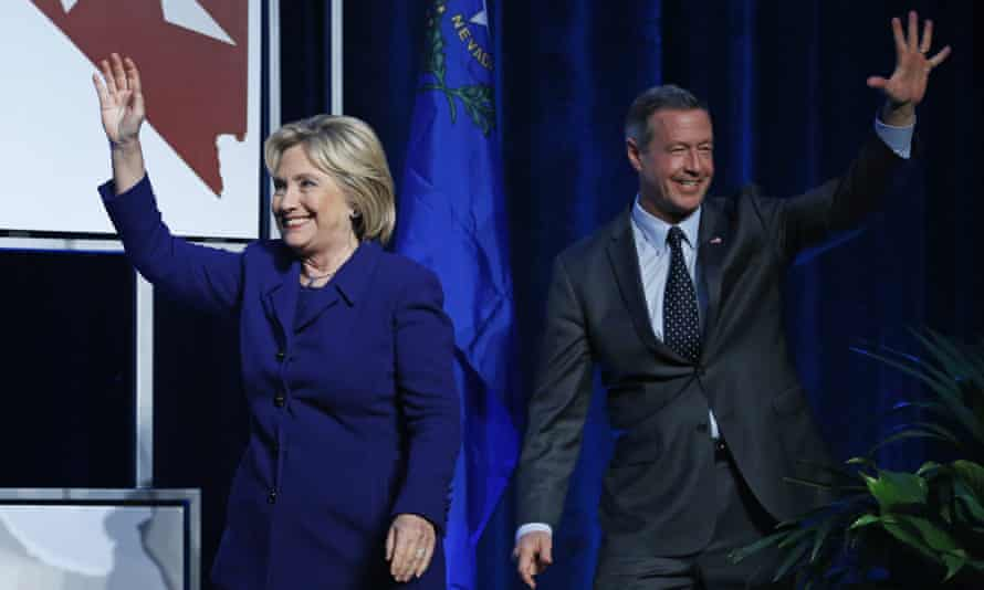 Democratic presidential candidates Hillary Clinton and Martin O'Malley walk on stage at caucus dinner.