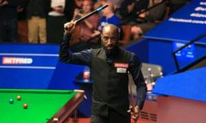 Rory McLeod celebrates following his shock victory over Judd Trump on day five of the World Championship in Sheffield