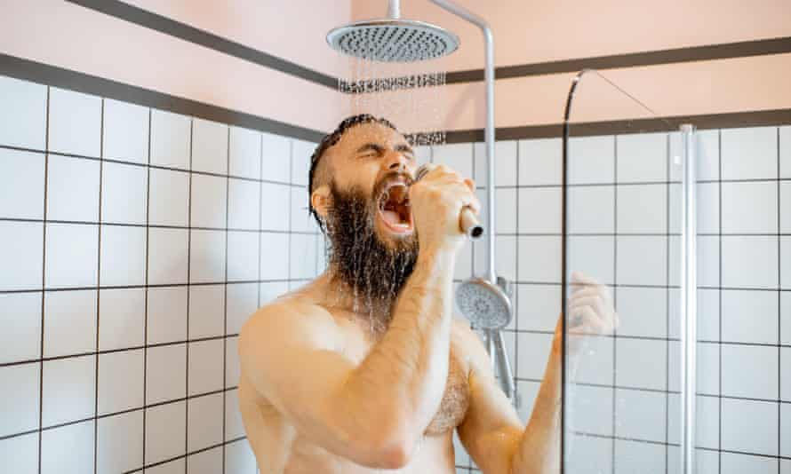 Bearded man singing in the shower