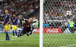Germany's Toni Kroos scores their second goal past Sweden's Robin Olsen to win the game 2-1 in the 95th minute at the Fisht Stadium.