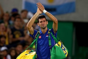 Novak Djokovic of Serbia shows his emotion after his defeat against Juan Martin Del Potro of Argentina in their singles tennis match.