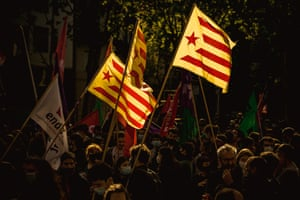 Members of left-wing groups march with their flags through Barcelona's city centre